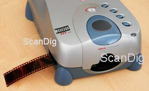 Film strips are being inserted in the scanner from the left front side